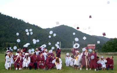 Seniors from the 2010 graduating class of Hoopa Valley High School throw their caps into the air to celebrate their graduation and the beginning of the next step in their lives. / Photo by Manuel Sanchez, Two Rivers Tribune.