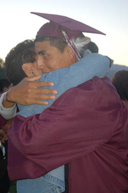 Hoopa Valley High School Senior, Clay Ramone, hugs his mother Tracey Ramone after graduating on June 11. Clay with attend College of the Redwoods in the fall to play football and baseball for the Corsiars. / Photo by Manuel  Sanchez, Two Rivers Tribune.