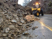 This rock slide temporarily closed State Route 96 west of Happy Camp. Several rock slides on  SR-96 and SR-299 caused road closures or controlled traffic throughout recent storms./Photo courtesy of actionnewsnow.com.