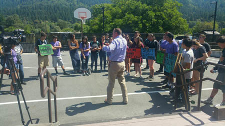 Jon Ray Superintendent at KTJUSD, steps outside the District office to answer questions from students who marched there in protest over mold and other issues./Photo courtesy of Lovae Blake, Hoopa Youth Council Coordinator.