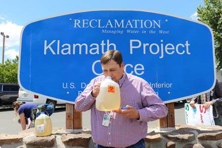 Klamath Regional Manager takes a whiff of the contaminated water samples that were collected by the youth out of the Klamath River Straight Drain./Photo courtesy of Youth Coalition for Clean Klamath.