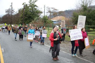 Nearly 50 marchers left Orleans School headed for the bridge across the Klamath River. By the time they got there, their numbers had nearly doubled. Add that to the definition of River Time./Photo by Konrad Fisher, Klamath Riverkeeper.