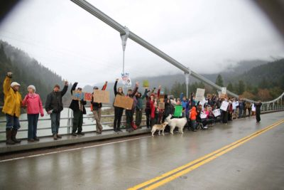 A light rain began falling on marchers as the paused at the Orleans Bridge for group-selfie style photos and, maybe, just to enjoy the river underneath and the scenery all around them. After that many gathered for a long conversation of the next steps to promote unity and self-sufficiency in the community./Photo by Konrad Fisher, Klamath Riverkeeper.