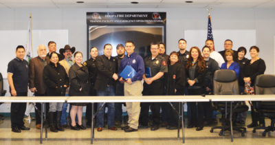 February 22, the Hoopa Valley Tribal Council, FEMA, Hoopa OES Incident Command Team and BIA representatives take a break for a photo opportunity after the signing ceremony./Photo by Teresa Mitchell, Two Rivers Tribune.