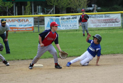 Hoopa Dodger Darvin Davis safely slides into second base on a steal during their game against the WC Nationals.