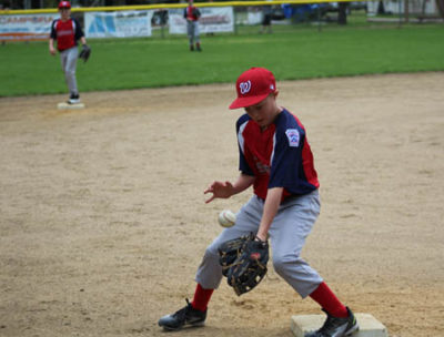 Wilson Medina, Willow Creek Nationals 3rd baseman, fields a throw from the outfield during the Klamath Trinity Little League jamboree at Candystick last weekend. The jamboree was a huge success and had more participation and volunteerism in recent years for the KTLL.