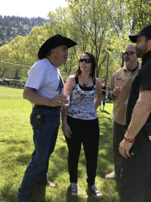 Bob Gimlin shares a friendly conversation with Chelsey Dickson, one of the organizers of Willow Creek's famed Bigfoot Days Celebration. The Bigfoot Festival on Saturday, April 29 mimicked the annual Bigfoot Days Celebration that is held every Labor Day weekend. Dickson also helped coordinate events at last weekend's festival./Photos by Allie Hostler, Two Rivers Tribune.