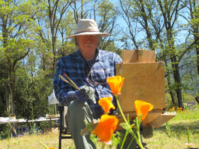 Rick Tolley, a painter from the coast, helped organize a painters' day Saturday with a team from the Karuk Tribe's Pikyav Field Institute. The field had been mowed in advance but the mower had left big clusters of California poppies./Photo by Malcolm Terence, Two Rivers Tribune Contributor.